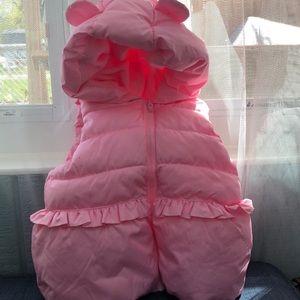 A pink vest.